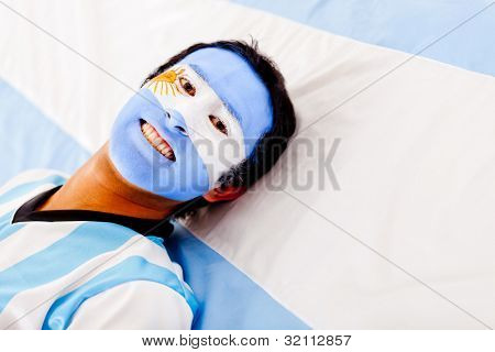 Man with the Argentinean flag painted on his face