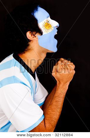 Argentinean man shouting - isolated over a black background