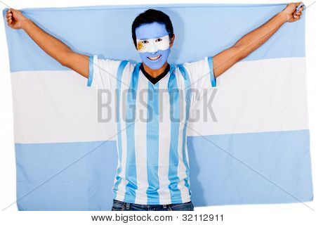 Happy Argentinean man smiling and holding the flag