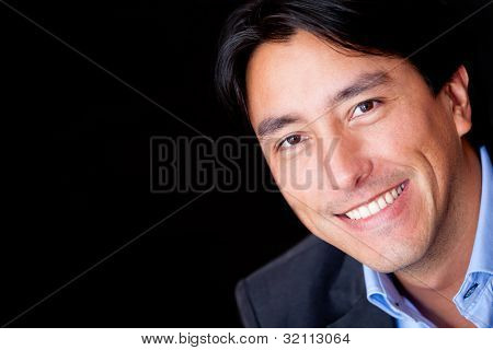 Portrait of a business man - isolated over a black background