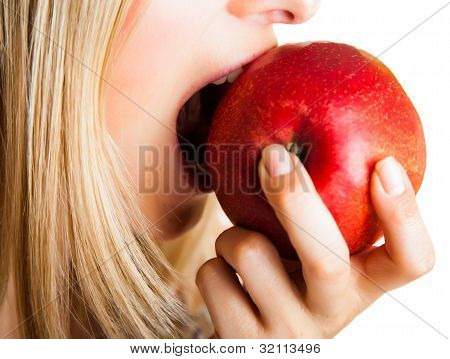 Beauty blond girl with apple isolated on white