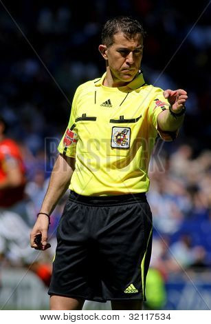 BARCELONA - APRIL 15: Referee Iglesias Villanueva during during a Spanish League match between RCD Espanyol and Valencia CF at the Estadi Cornella on April 15, 2012 in Barcelona, Spain