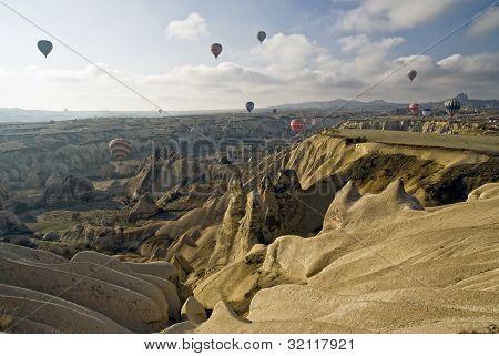 Hot Air Ballons Flying On The Sky Of Cappadocia. Turkey.