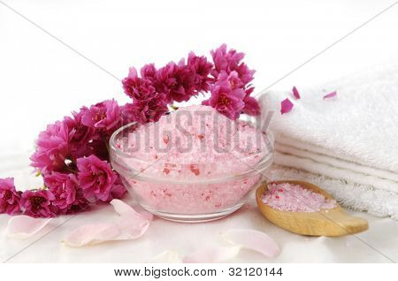 spa set- towel and plum flower. candle on soap, salt in spoon