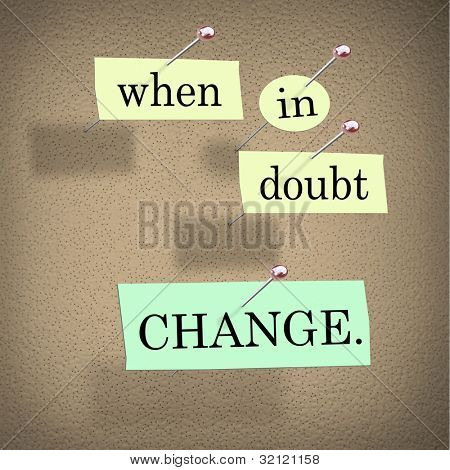 The words When in Doubt Change pinned to a cork bulletin board representing self-help improvement advice to motivate you to make positive changes in your life for success