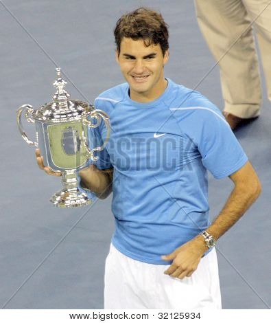 FLUSHING, NY - SEPTEMBER 10: Roger Federer holds his trophy after winning against Andy Roddick during the US Open at the USTA National Tennis Center on September 10, 2006 in Flushing, NY.