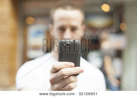 Men Take Photo With Mobile Phone