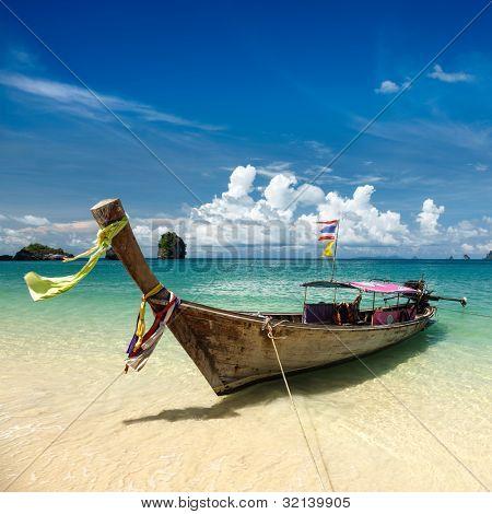 Long tail boat on tropical beach, Krabi, Thailand