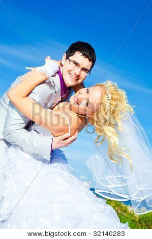 Happy Groom And Bride On A Sea Coast