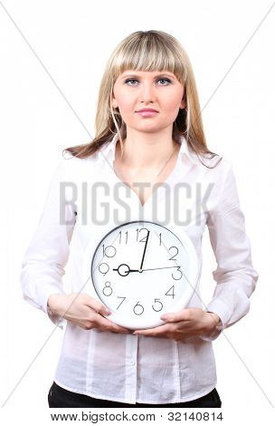 Young business woman holding clock isolated on white