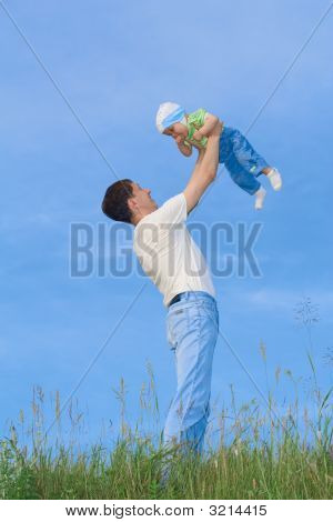 Young Boy Playing With Father