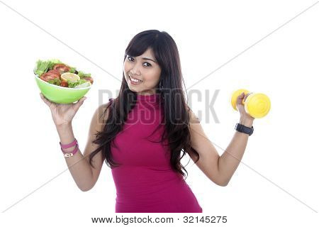 Woman With Fitness Food And Dumbbell