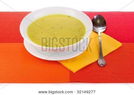 Tasty soup on red tablecloth isolated on white