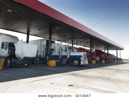 Trucks At Gas Pump Station Off Highway