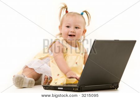 Adorable Baby With Laptop