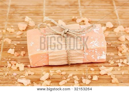 Hand-made natural soap on wooden mat