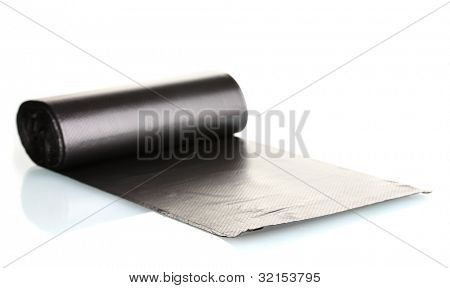 Roll of black garbage bags isolated on white