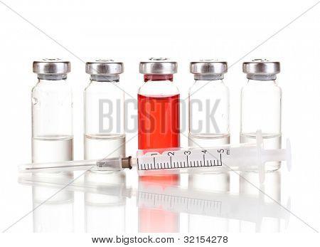 Syringe and medical ampoules isolated on white