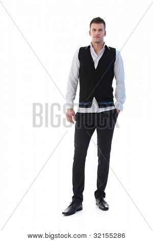 Trendy businessman standing confidently, looking at camera.