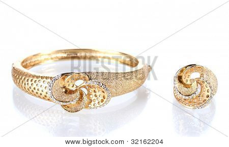 Beautiful golden bracelet and ring with precious stones isolated on white
