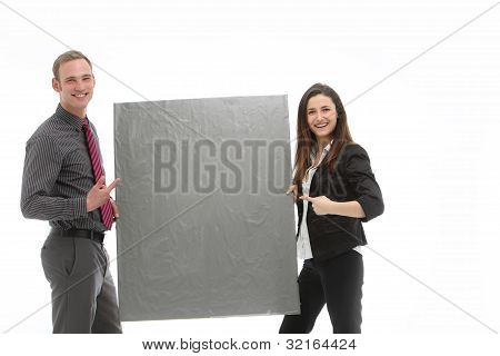 Successful Business Team Holding Blank Board