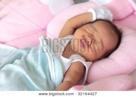 face of infant baby in the bed