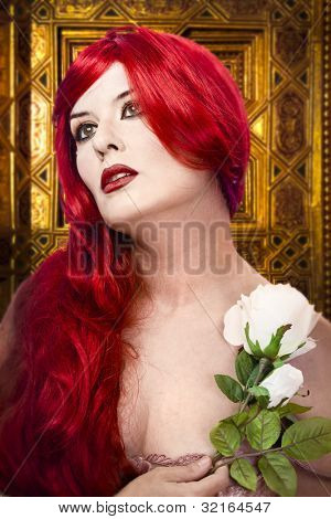 Gothic woman with white rose in her hand, gold ornament background