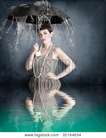 Pin-up girl with umbrella under water splash with river reflection