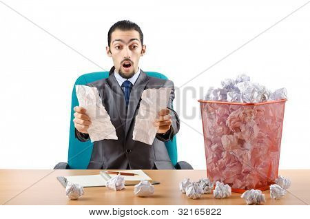 Man with lots of wasted paper