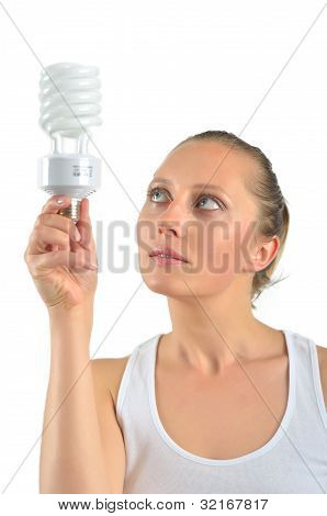 Beautiful Young Woman Having An Idea With Holding An Energy-saving Bulb And Thinking Isolated