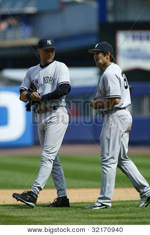 NEW YORK - MAY 20: Derek Jeter #2 and Johnny Damon #18 of the New York Yankees walk together on the field as they play against the New York Mets on May 20, 2006 at Shea Stadium in Flushing, New York.