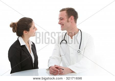 Smiling Doctor Giving Good News To Patient