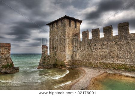 Old walls of ancient castle on Lake Garda in Sirmione, Northern Italy.