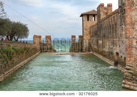 Ancient walls of medieval castle on Lake Garda in Sirmione, Northern Italy.