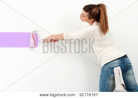 Cute Girl Painting The Wall.