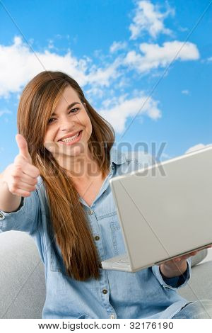 Cute Girl Showing Thumbs Up With Laptop.
