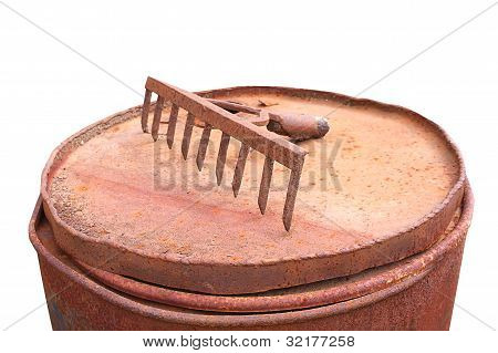 Rusty Rake On Rusty Barrel Garden Tools Old On White Background