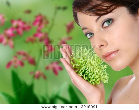 Beautiful Woman With Green Chrysanthemum With Green Floral Spa Background