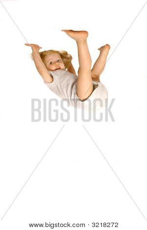 Toddler Girl In White Vest Hanging Upside Down