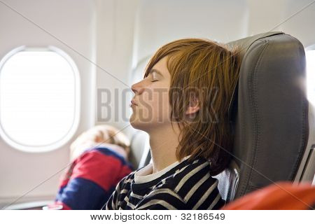 Boy Sleeping In The Aircraft