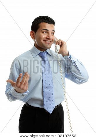 Businessman In Discussion On Telephone