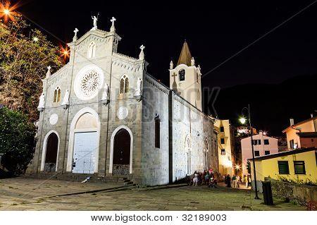 Illuminated Church In The Village Of Riomaggiore At Night, Cinque Terre, Italy