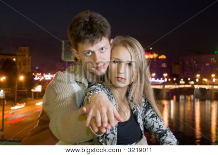Young Couple Against Night City