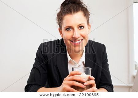 Smiling Woman Holding Glass Of Chocolate Drink