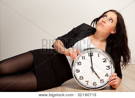 Bored Employee With A Clock