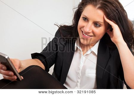 Young Business Executive Reading Text Message