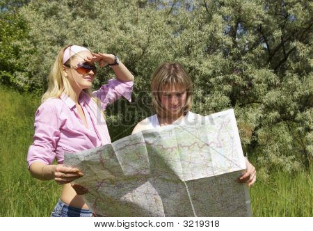 Girls Look At The Map