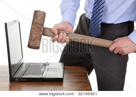 Businessman with a sledgehammer ready to smash his laptop computer concept for frustration, failure or stress