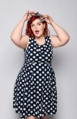 Beautiful Style Portrait Of A Full Fat Woman Plus Size In A Retro Dress And Makeup, A Polka Dot Dres poster