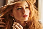 Portrait of a beautiful red-haired girl. Beauty and make-up concept. Hippie style. Bohemian style. poster